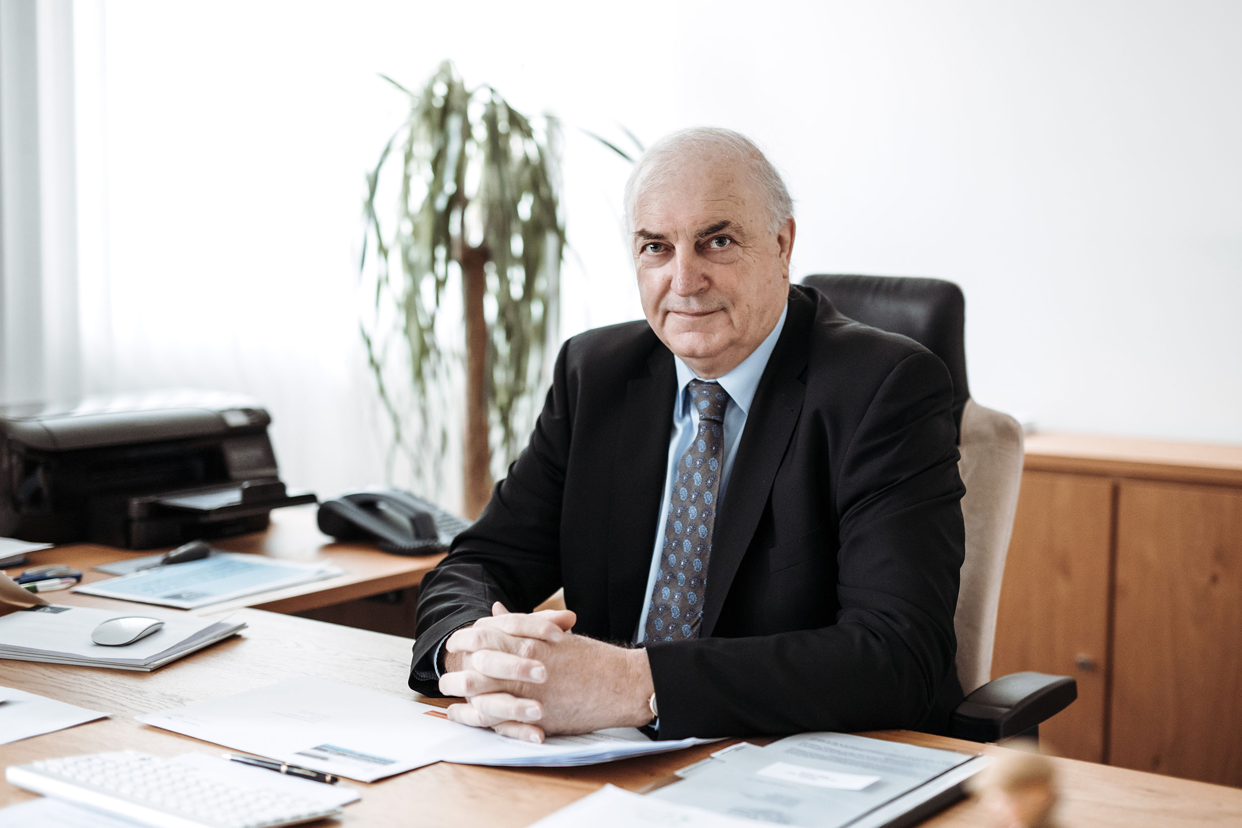 Charles Goerens is sitting at his desk.